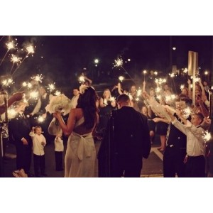 couple facing wedding sparklers